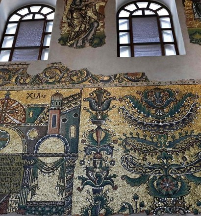 A picture taken on November 30, 2018, shows details of mosaic on the nave walls of the Church of the Nativity in the occupied West Bank biblical city of Bethlehem. - The Italian government and the Palestinian Authority have been working in a joint effort to restore the Church of the Nativity since 2013.It is one of the first Christian Churches, associated to the birthplace of Jesus. The cost of the Nativity renovation is around 18 million euros ($20.5 million),funded by the Palestinian Authority, the Vatican and other governments according to authority. (Photo by THOMAS COEX / AFP)
