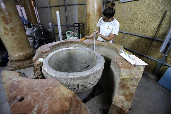 epa07665978 Archeologists work at the site where a Byzantine baptism font was discovered during restoration work at the Church of the Nativity, in Bethlehem, 22 June 2019. According to reports, head of the Palestinian Committee in charge of the Church restoration Ziad al-Bandak announced the discovery of a baptismal font during the restoration work of the Church of the Nativity that is probably dating back to 6th century AD.  EPA/ABED AL HASHLAMOUN